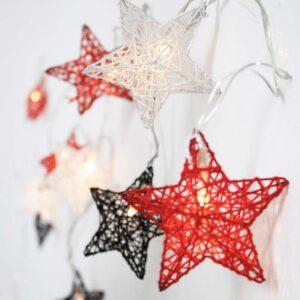 Luces de navidad, guirnaldas con forma de estrellas en color blanco, rojo y negro
